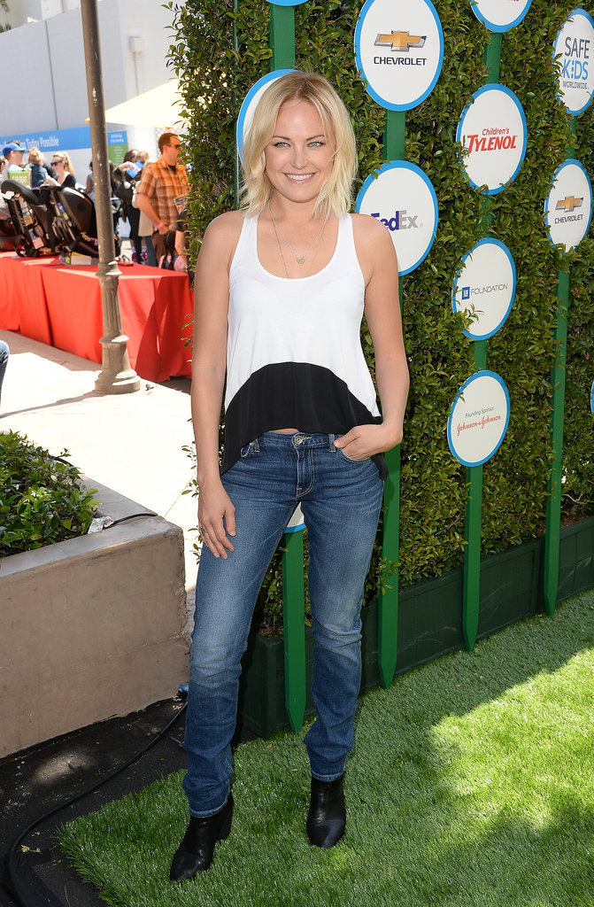 Malin Akerman struck a pose on the grass carpet.