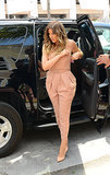"Khloé Kardashian proved the jumpsuit could just be the modern ""ladies-who-lunch"" look in a peachy, strapless version."