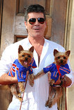 Simon Cowell dressed up his two dogs for a special event for Britain's Got Talent in London on Tuesday.