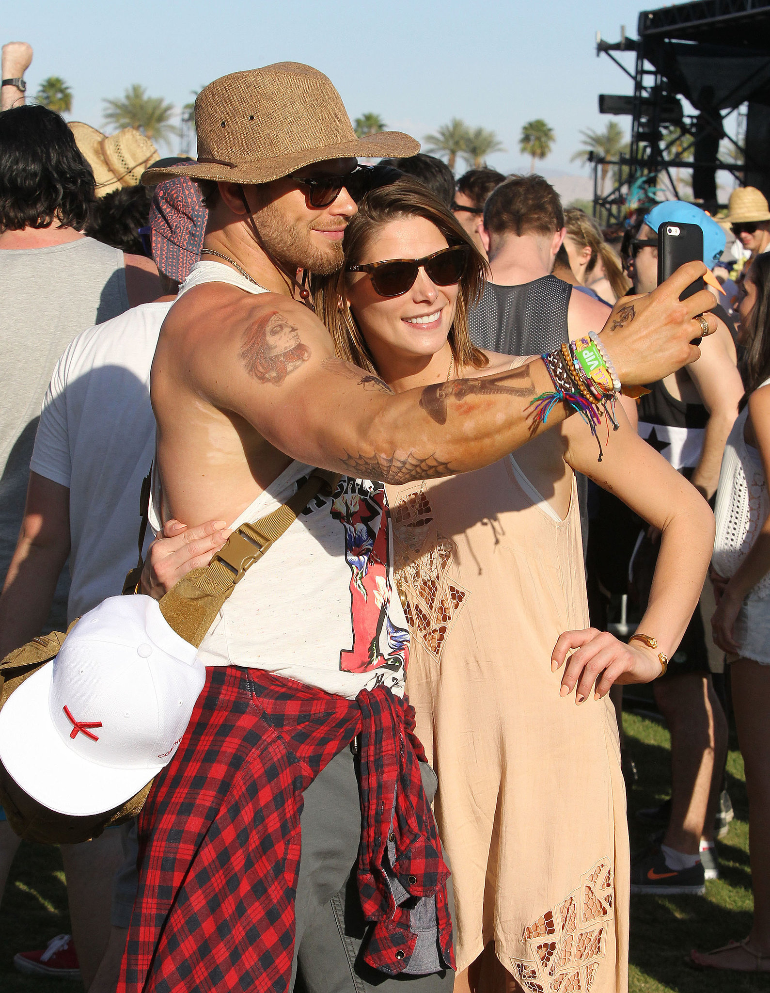 Kellan Lutz showed off his guns while taking a selfie with Ashley Greene.
