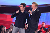 Conan O'Brien and Adam DeVine kicked off the night with a song.