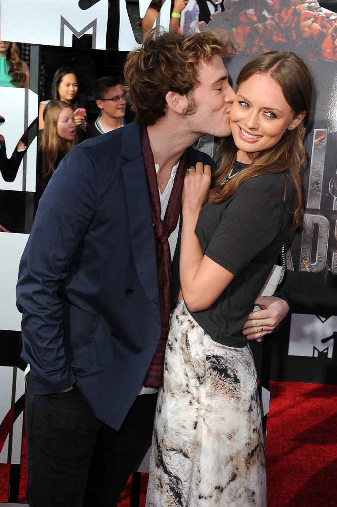Sam Claflin gave Laura Haddock a kiss and a squeeze.