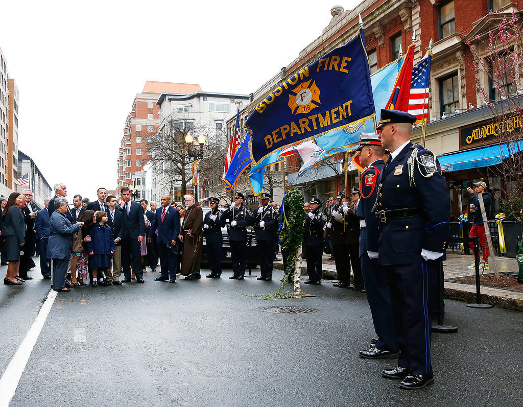 Flags waved during the wreath-laying ceremony commemorating the one-year anniversary of the Boston Marathon bombing.