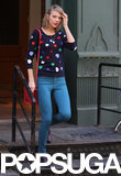 Taylor Swift wore a heart sweater during a day out in NYC on Wednesday.