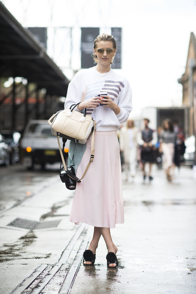 With pompoms, these mules feel just a bit boudoir-inspired, but this style setter balances out the playful vibe with a tomboy sweatshirt and soft petal-pink skirt.<br /> Source: Gorunway.com/Matteo Catena<br />