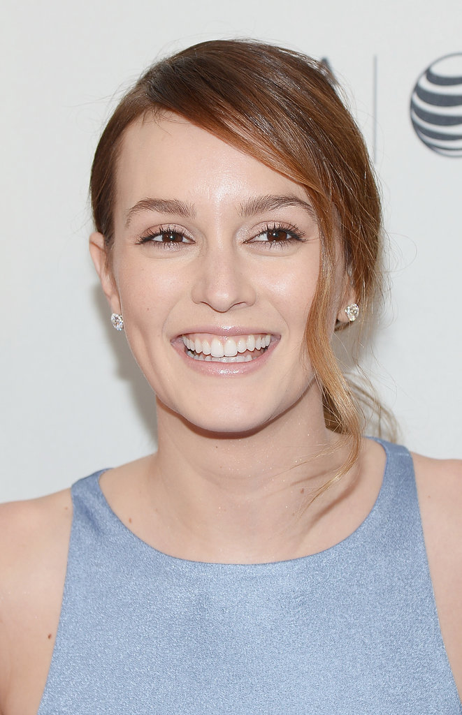 Leighton Meester giggled on the carpet.