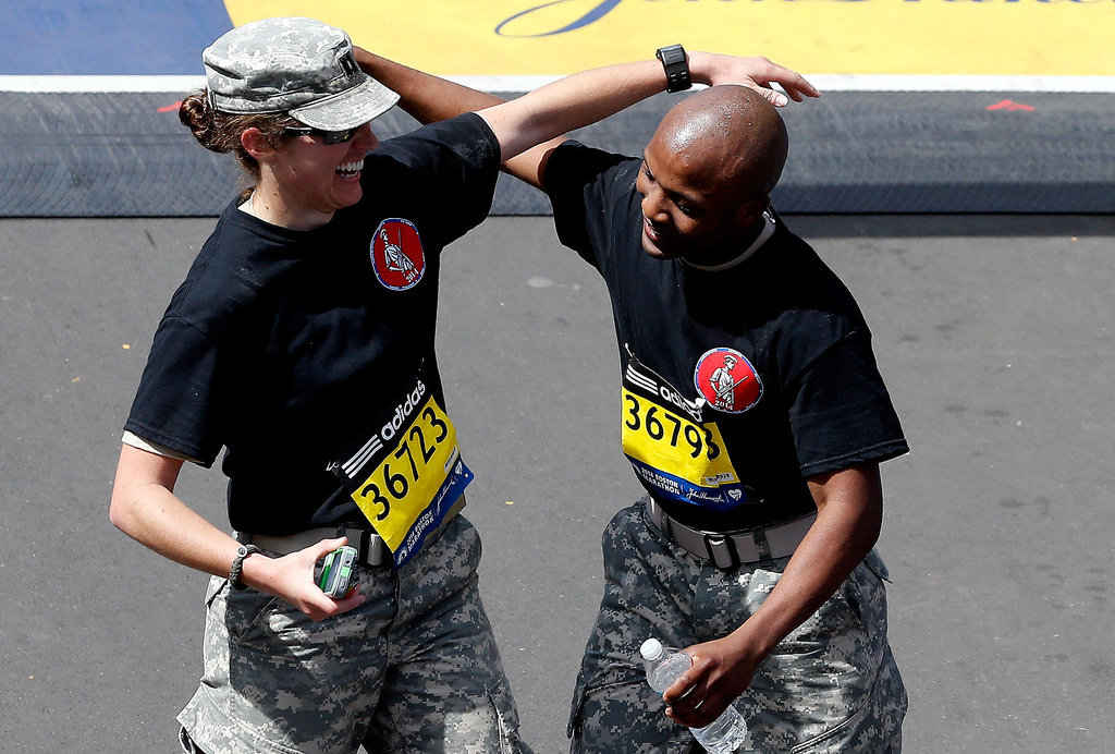 Two soldiers celebrated after completing the marathon together.