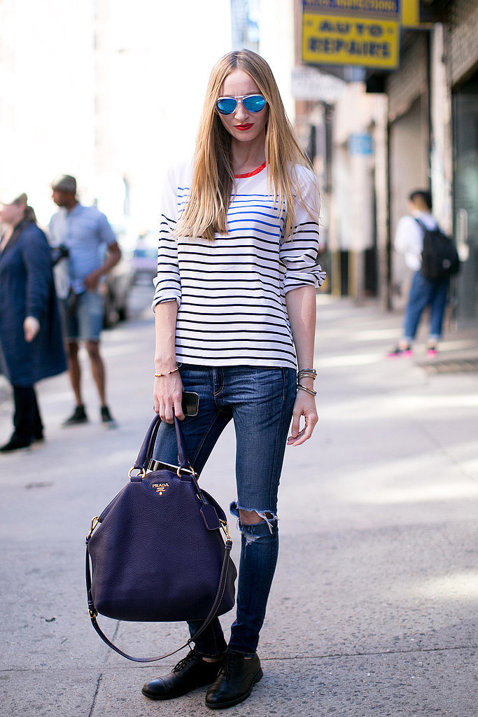 Don't overthink it — often the best rain gear is all your go-to pieces. You can't go wrong with skinny denim, a striped tee, and a pair of walkable brogues.
