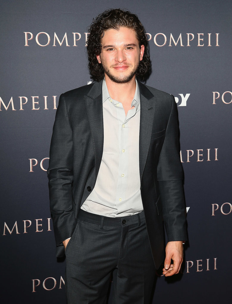 Typically, Kit goes for a casual, simple smirk like this.