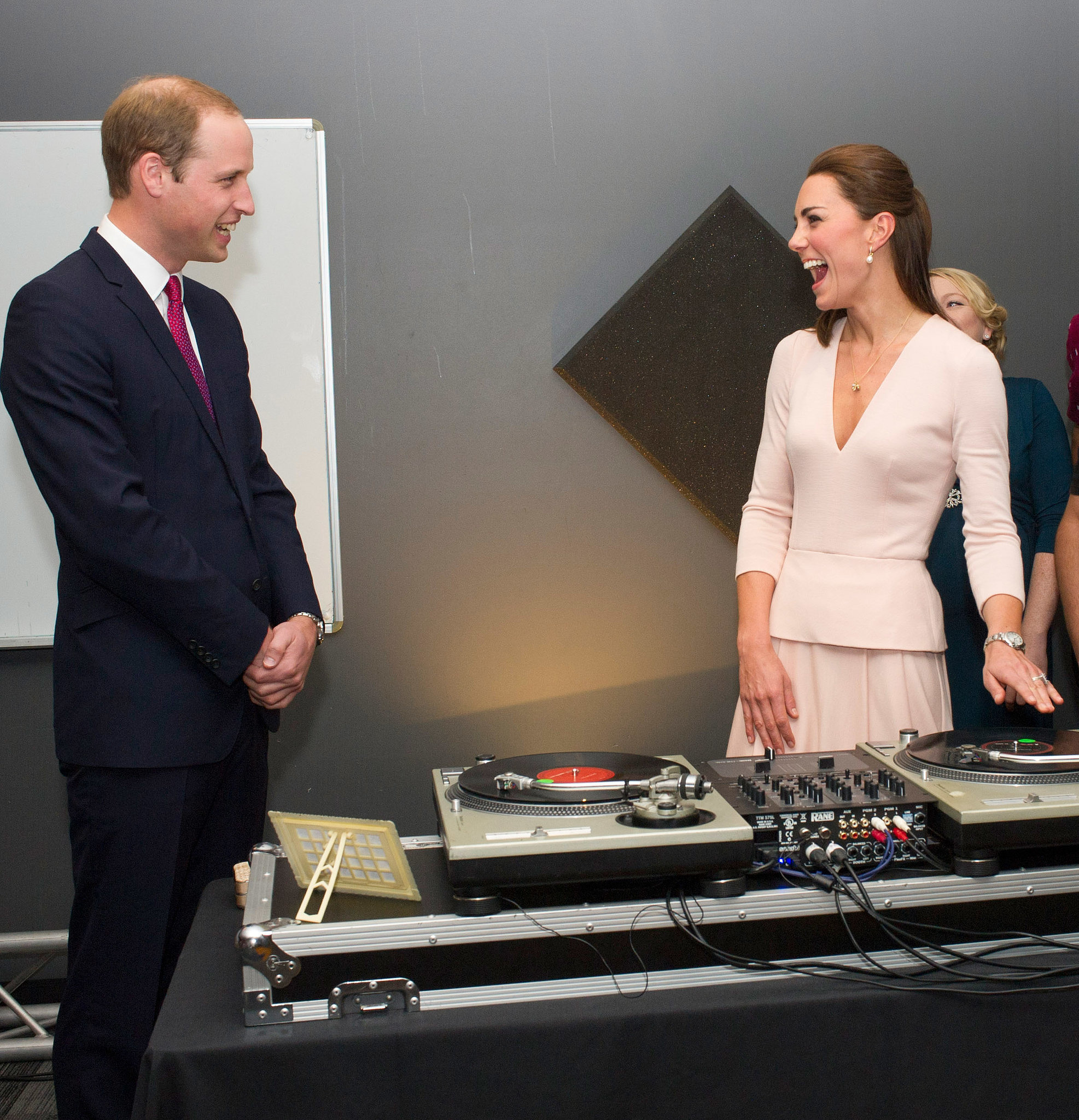 Kate cracked up while channeling her inner DJ in front of Prince William in Adelaide, Australia, during their April 2014 royal tour.