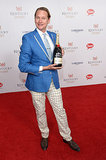 Carson Kressley struck a pose with a bottle of Champagne.