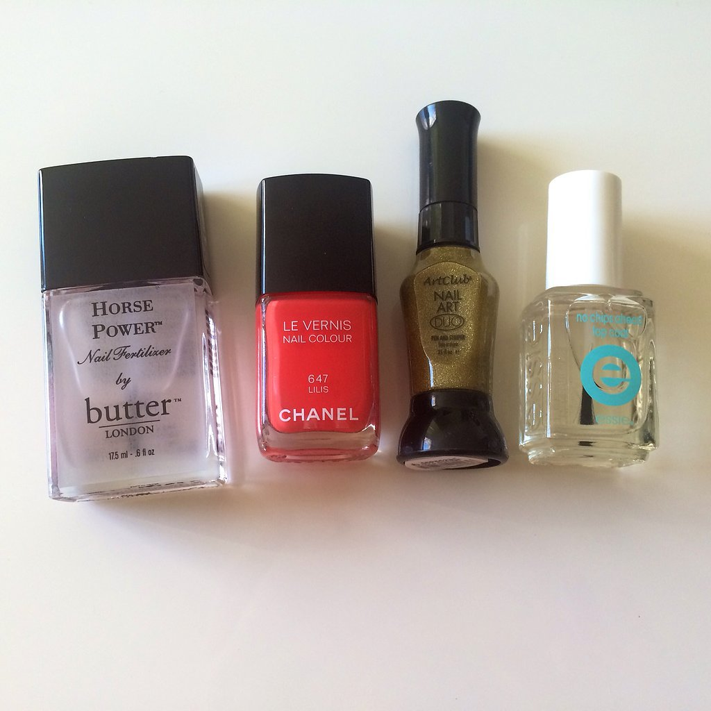 For Spring, I was inspired to forgo the traditional red and try a bright coral, Chanel Le Vernis Nail Colour in Lilis ($27). I used Butter London Horse Power ($19) as a base coat, Art Club Gold Glitter Duo Pen ($4) to create the gold accent, and Essie No Chips Ahead ($9) to seal in my look.