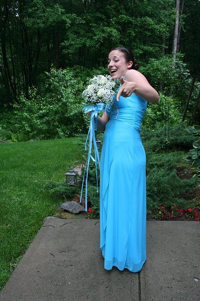 """Blue always has and always will be my favorite color, so I knew I had to wear a blue gown for my last big dance. This dress was one of the first I tried on — it was a perfect fit. The Grecian-style top really worked on my smaller bust, and the bottom flowed out just enough that I could comfortably bust a move on the dance floor. If I ever get married, I would love to wear a white version of this gown."" — Leah Rocketto, Moms assistant editor"