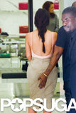 Kanye grabbed Kim's famous bum during their shopping trip.