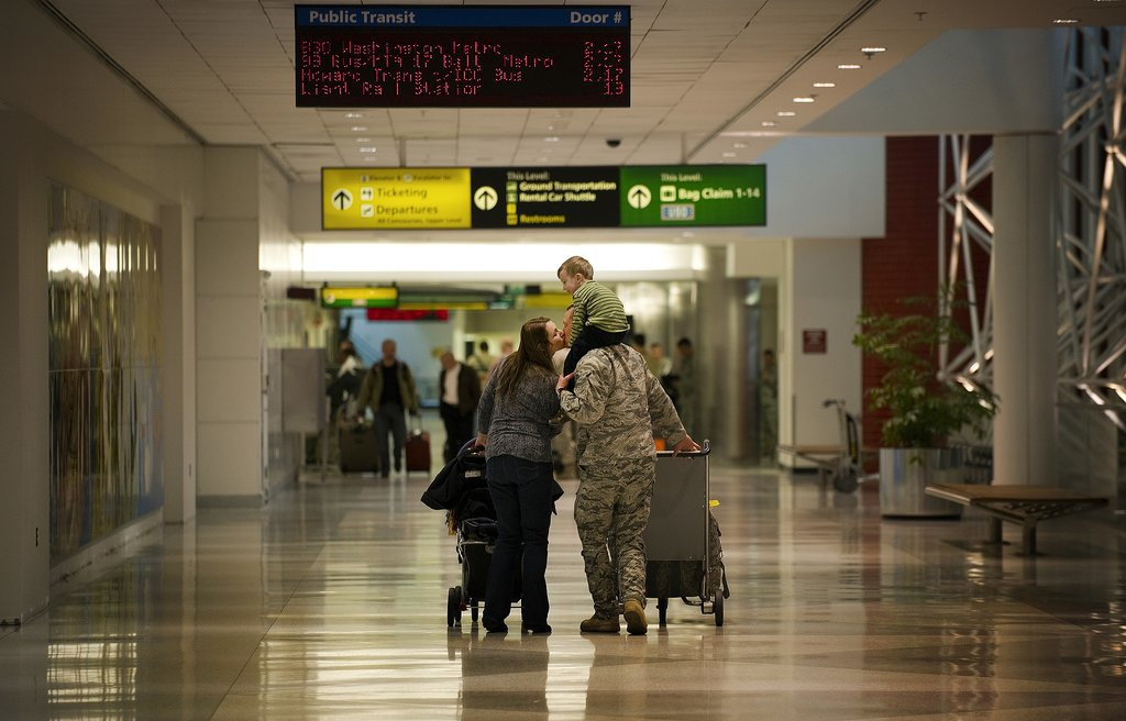 One of the the last Air Force personnel to return from Iraq, Commander of the 22nd Expeditionary Weather Squadron, Major Steven Vilpors, kissed his wife, Joanne, while giving his son Connor a ride on his shoulders at Baltimore Washington International Airport in Baltimore on Dec. 20, 2011.