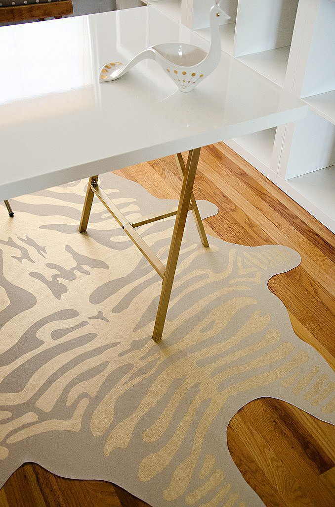 Kraft paper, scissors, vinyl, and gold leaf pens are all it took to make this DIY zebra rug. Color us impressed! Source: Brittany Makes