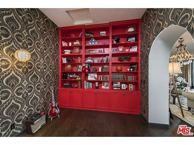 Red cabinetry adds a pop of color. Source: Coldwell Banker