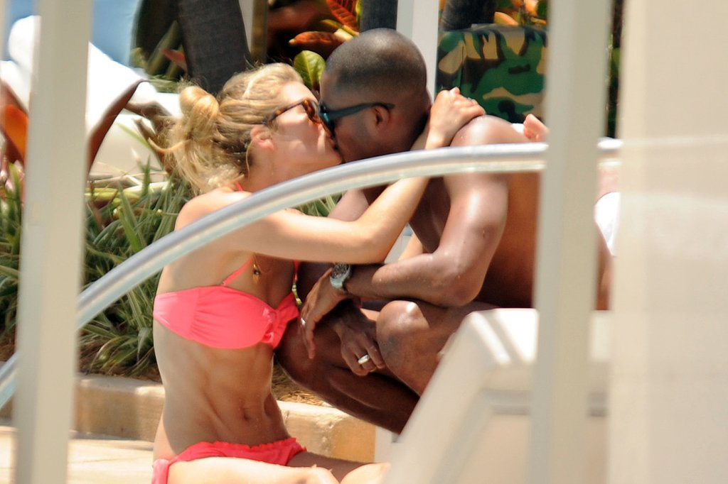 Doutzen Kroes smooched with husband Sunnery James during a day by the pool in Miami in June 2012.