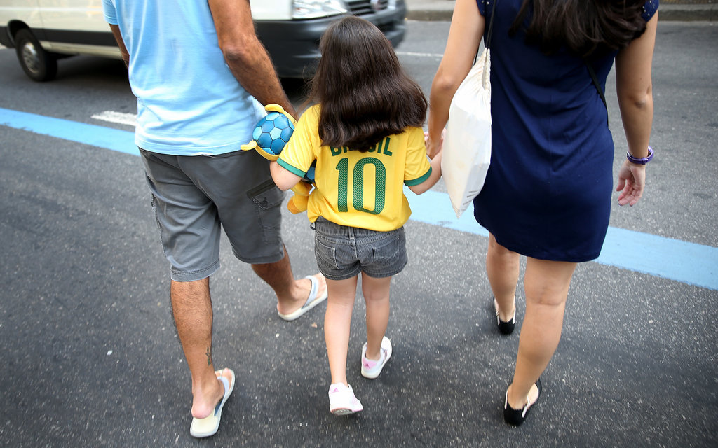 A little girl showed off her Brazil jersey.