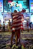 A couple kissed with the American flag wrapped around them while watching a game in Rio de Janeiro, Brazil.