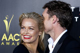 Walking the red carpet with her man Sam Worthington at the AACTA Awards in Sydney in Jan. 2014.