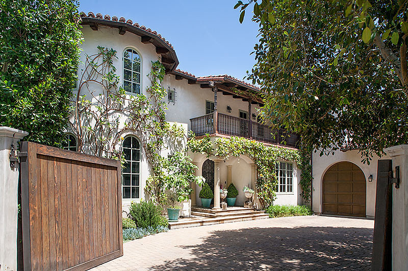 The gated entrance to the home offers plenty of privacy for the double lot.  Source: David Offer