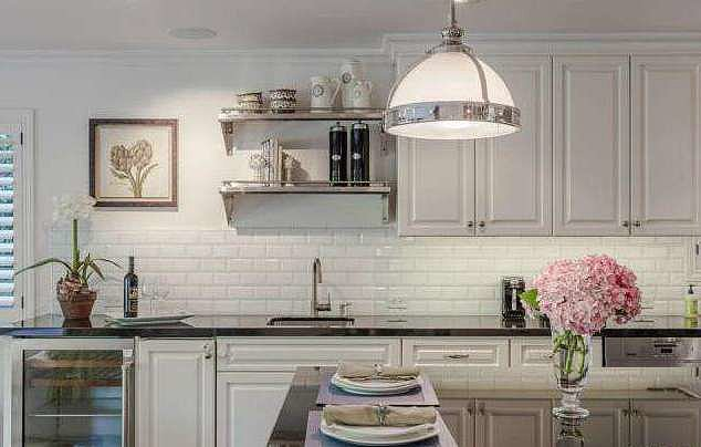 Another look at the kitchen — we love those white subway tiles!  Source: Redfin