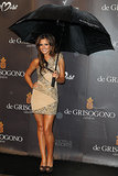 Celebrating the launch of a collaboration with De Grisogono, Cheryl didn't let rain stop play as she posed in a sparkling minidress.