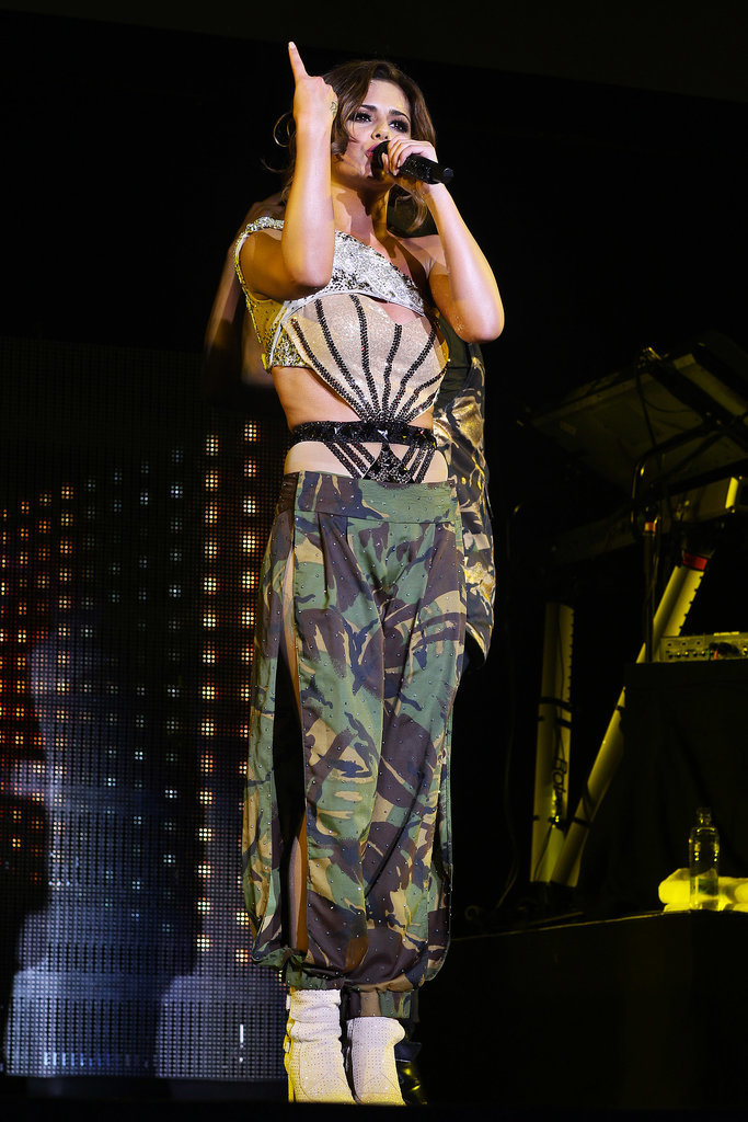 Supporting The Black Eyed Peas, Cheryl rocked a camouflage outfit that stripped off to reveal a strappy lingerie-inspired look.