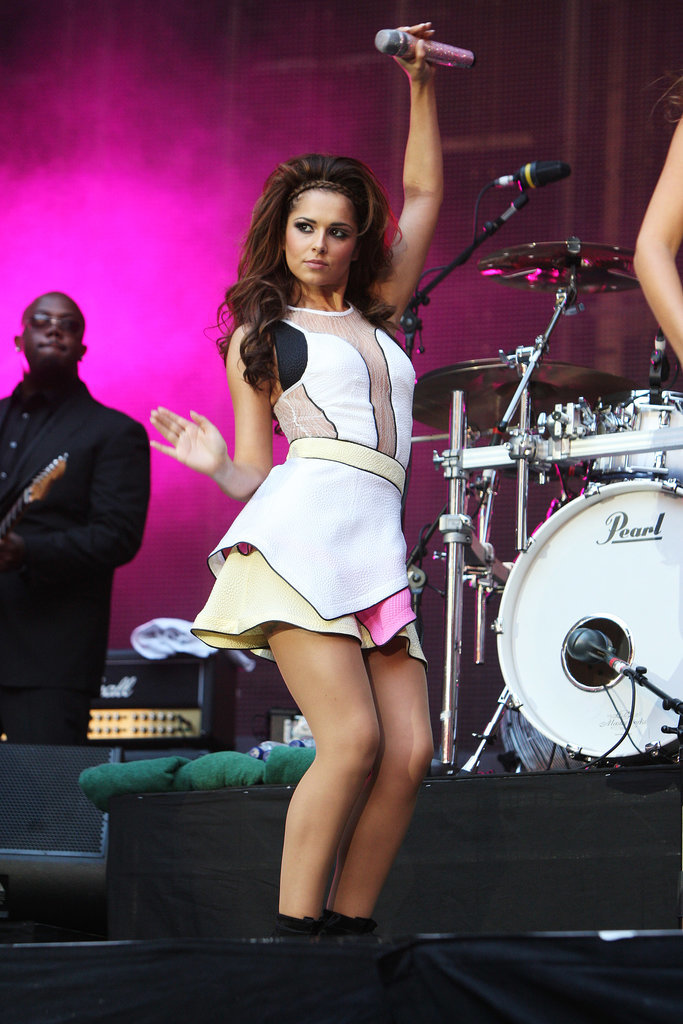 When Girls Aloud played Wembley Stadium (supporting Coldplay), they went big with their costumes. This neon-trimmed mini was one of many looks Cheryl sported during the set.