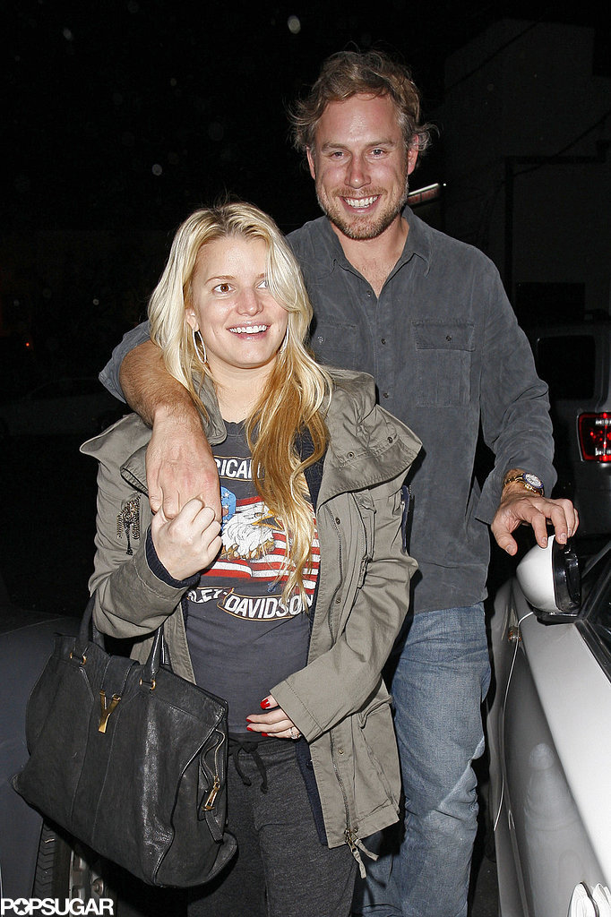 Eric kept his arm around pregnant Jessica as they left an LA restaurant in November 2011.