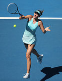 Maria Sharapova took a swing in a layered blue outfit at the 2014 Australian Open.