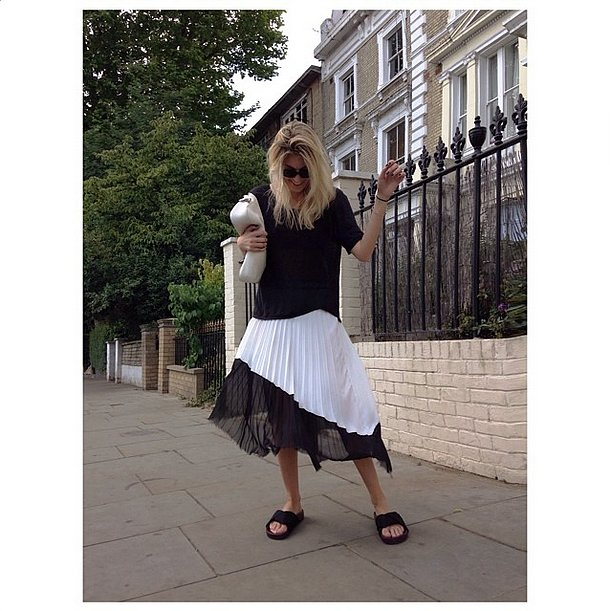 A casual, loose tee doesn't appear so sloppy once it's been layered over a pleated midi skirt. Source: Instagram user camtyox