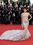Eva Longoria (again) chose a glamorous Marchesa gown for the Cannes Film Festival in 2012, and we think she actually managed to outdo herself! The pale, illusion-embroidered gown with a sweeping train and delicate embroidery was breathtaking on the red carpet.