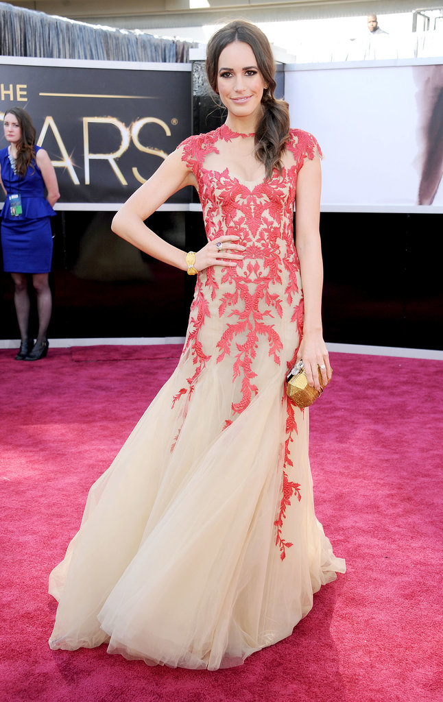 TV presenter Louise Roe wore this crimson and cream Monique Lhuillier dress to the Oscars in 2013.