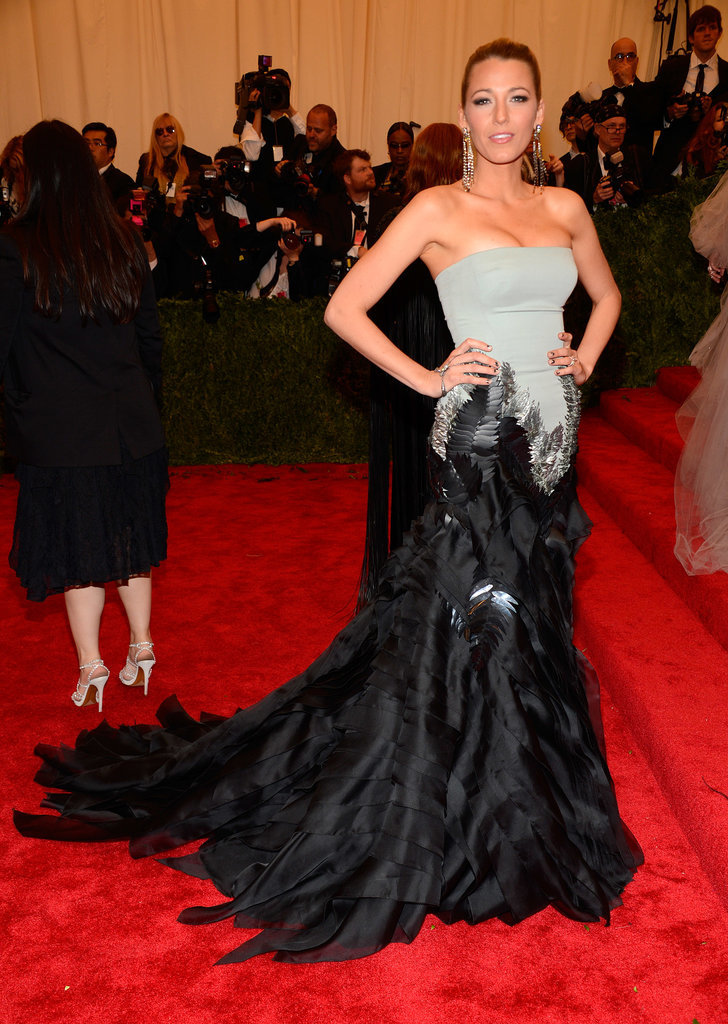 Blake Lively attended the Met Ball 2013 in an exquisite feathered Gucci Première gown.