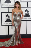 Chrissy Tiegen sparkled in this heavily glittered Johanna Johnson gown. We love the fluid train.