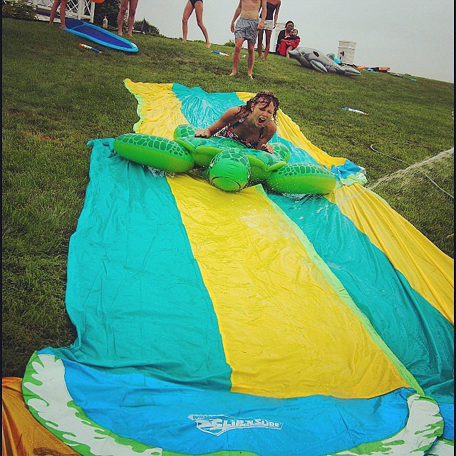 "The ladies got ""nonstop rain"" on the Fourth of July, so they took trips down a Slip 'N Slide.  Source: Instagram user taylorswift"