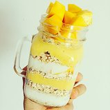 Overnight oats get a parfait makeover with layers of mango and yogurt for a seasonal Summer treat.  Source: Instagram user yookira