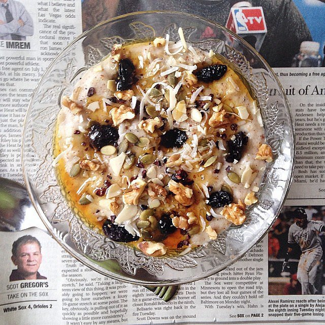 Overnight oats mean less time cooking breakfast and more time reading the news. After pulling these oats from the fridge, the bowl was topped off with agave nectar, raw coconut, and trail mix. Source: Instagram user unefruitgirl
