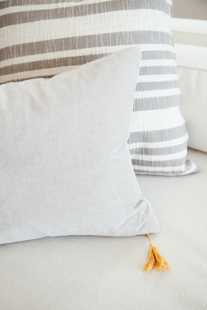 Natural fabrics and textures help the home feel cozy yet clean.  Photo by Tessa Neustadt via Homepolish