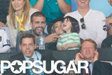 Gerard Piqué, Shakira, and Milan cuddled in the stands.