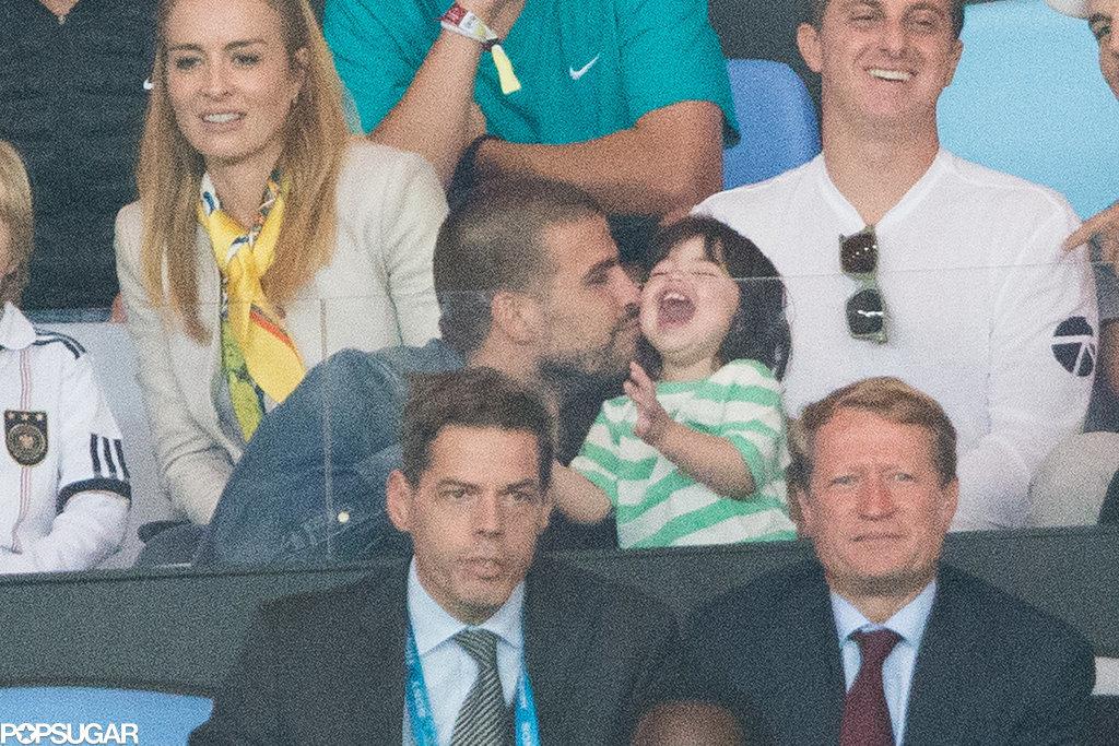 Gerard Piqué gave his son, Milan, a kiss.