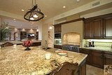A multilevel kitchen island suits cooking and eating. Source: Realtor.com