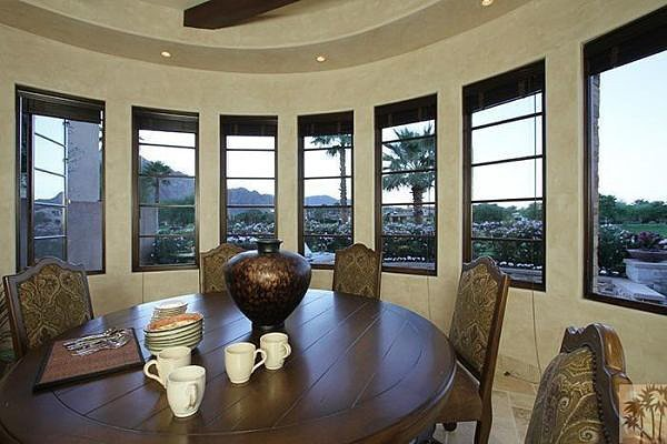Surrounded by windows, this breakfast nook feels anything but claustrophobic.  Source: Realtor.com