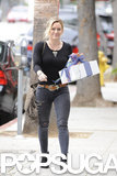 Hilary Duff toted a wrapped gift as she made her way through LA's Studio City neighborhood on Saturday.