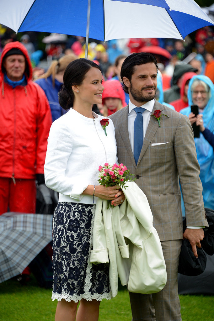 He held up an umbrella for Sofia at Crown Princess Victoria's birthday celebration in July 2014.