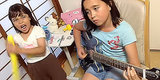 10-Year-Old Girl's Guitar Cover Of Slayer Is Insane (With Hilarious Backup Vocals Bonus)