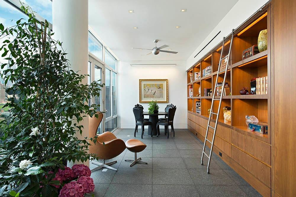 A cozy library nook complete with a ladder. Source: Town Real Estate