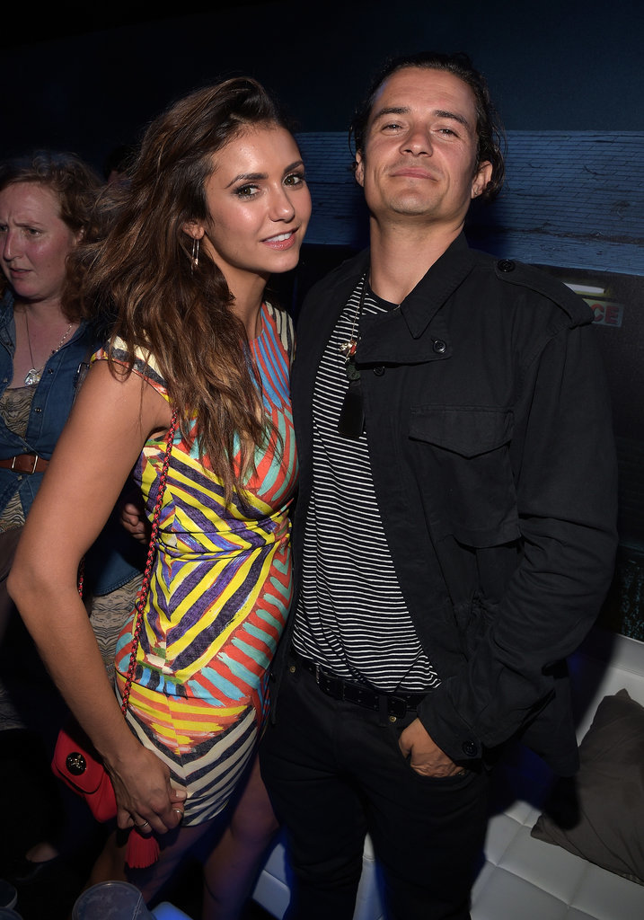 "Nina was reportedly ""casually flirting and dancing"" with Orlando Bloom at a Playboy party during Comic-Con. But how casually?"